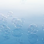 Multiple bubbles floating on the surface of calm water
